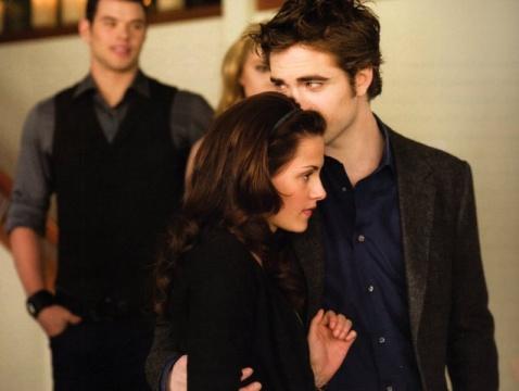 Bella's hair lookin tight in the bday scene